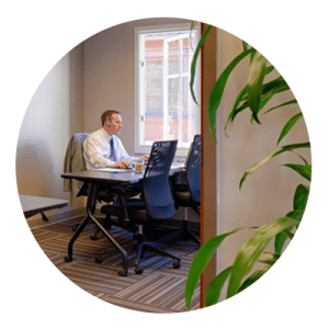 man working in private office