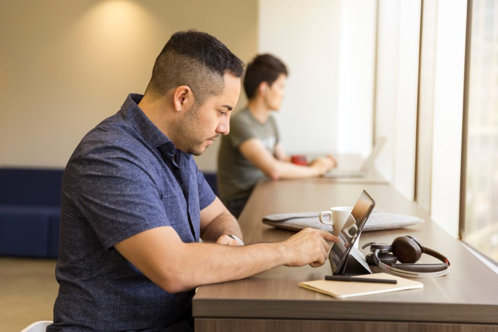 Shared office with man on a tablet