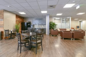 event space with kitchen and tables and chairs
